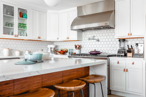 A clean, staged kitchen, something you should do when you want to take real estate photos.