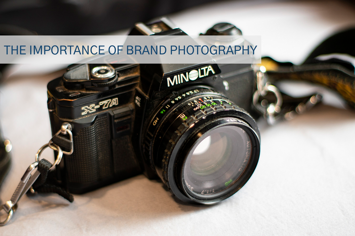 Brand photography of a camera on a white table